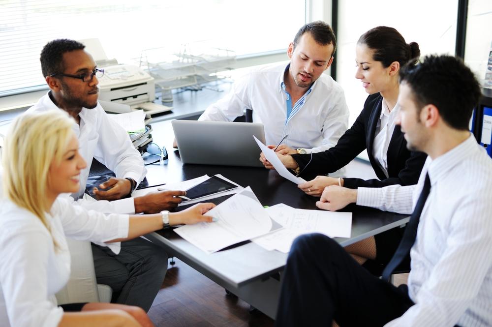 Business people working in office having meeting
